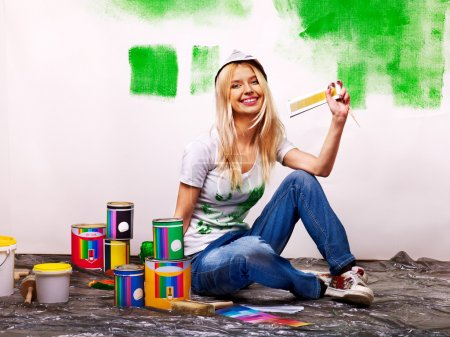 Photo for Happy woman paint wall at home. - Royalty Free Image