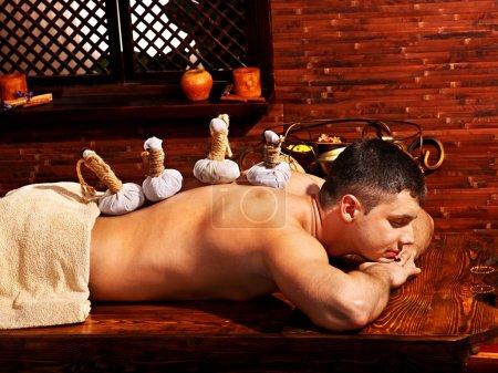 Man having Ayurvedic spa treatment.
