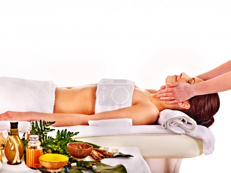 Woman getting spa head therapy .