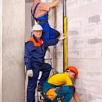 Happy group men in builder uniform indoor....