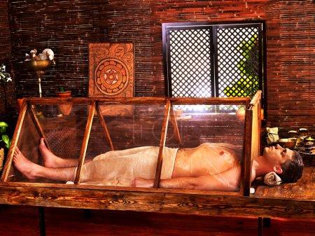 Man having Ayurveda sauna.