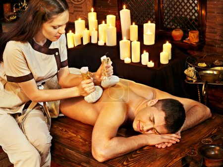 Photo for Young man having Ayurveda spa treatment. - Royalty Free Image