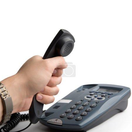 Foto de Teléfono en mano sobre fondo blanco - Imagen libre de derechos