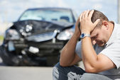 Upset man after car crash