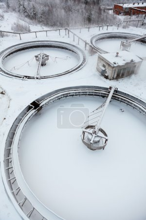 Three empty circular settler on sewage treatment plant in winter season