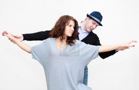 Dance teacher working with woman
