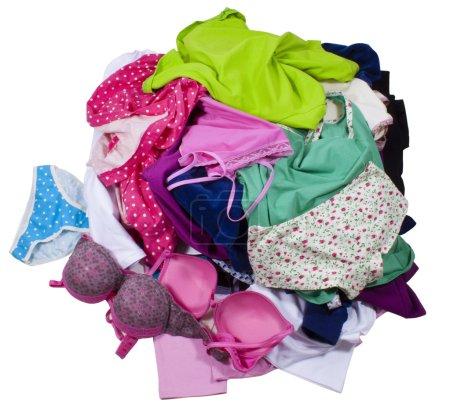 Foto de Mucha ropa colorida desordenado aislado sobre fondo blanco. trazados de recorte incluidos. - Imagen libre de derechos