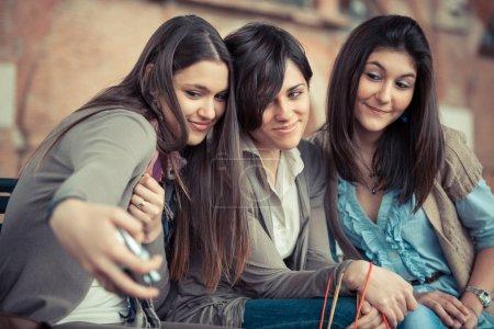 Three Beautiful Women taking Self Portraits