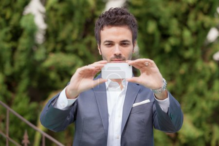 Young Businessman Taking Photos with Mobile