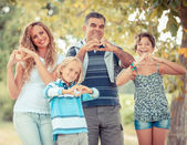 Happy Family with Heart Shaped Hands