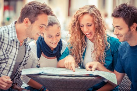 Photo for Group of Tourists Looking at Map - Royalty Free Image