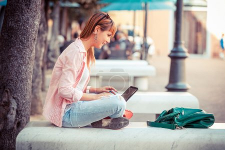 Photo for Beautiful Young Woman with Computer Outside - Royalty Free Image