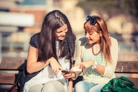 Photo for Two Young Women with Mobile Phone - Royalty Free Image
