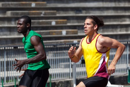 Two Track and Field Athletes Running