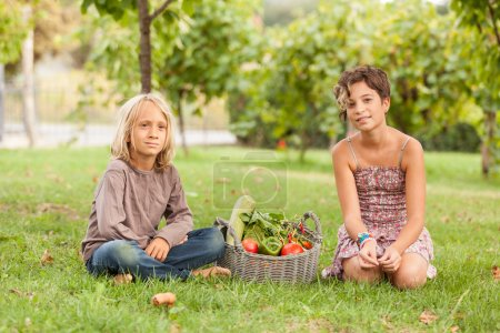 Photo for Boy and Girl Holding Basket of Vegetables - Royalty Free Image