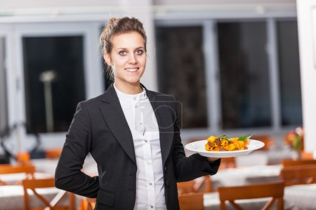 Photo for Waitress in the Restaurant Holding Dishes - Royalty Free Image