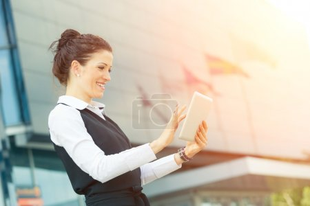 Photo for Young Businesswoman with Digital Tablet at Financial District - Royalty Free Image