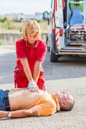 Rescuer Practicing Heart Massage