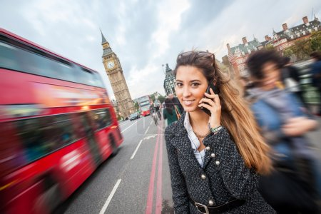 Photo for Young Woman Talking on Mobile in London - Royalty Free Image
