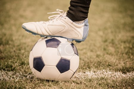 Soccer Ball and Player Foot