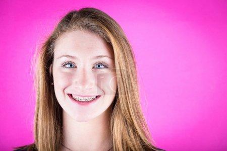 Smiling Beautiful Girl with Braces on Fuchisa Background