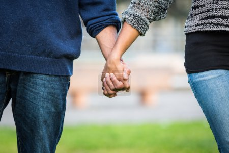 Photo for Mixed-Race Couple Holding Hands - Royalty Free Image