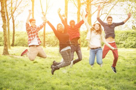 Photo for Happy Teenage Group Jumping Outside - Royalty Free Image