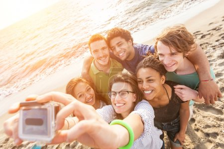 Multiracial Group of Friends Taking Selfie at Beac...