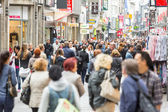 COLOGNE, GERMANY - MAY 07, 2014: Crowded shopping street in Cologne