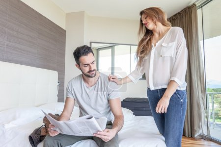 Man Reading and wife wants attention