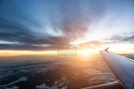 Cloudy sky through airplane window
