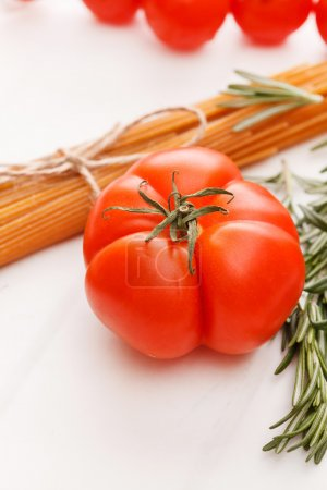 Photo for Pasta with tomatoes and herbs - Royalty Free Image