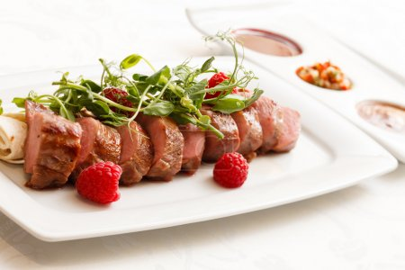 Grilled duck breast with sauce