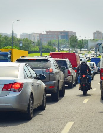 Photo for Motorcyclist among traffic - Royalty Free Image