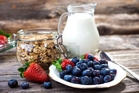 Photo for Healthy Breakfast milk and berries on table - Royalty Free Image