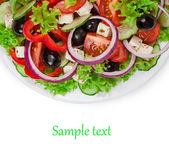 Salad on a plate isolated on white background