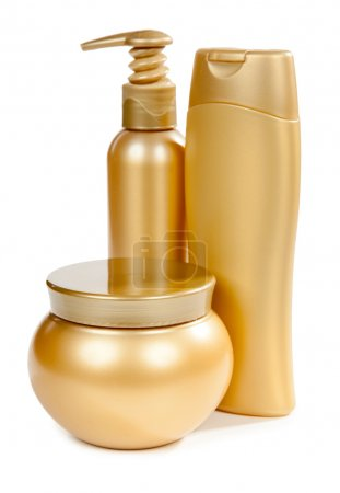 Bottles of golden color with shampoo and soap and cosmetics