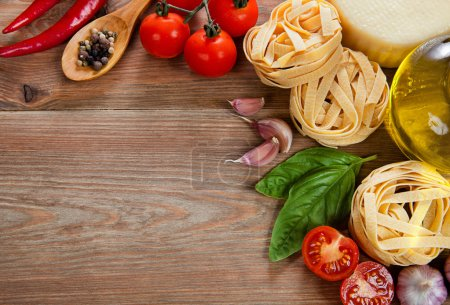 Photo for Italian cuisine. Vegetables, oil, spices and pasta on the table - Royalty Free Image