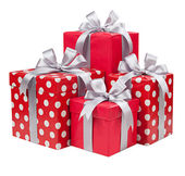 Red boxes with gifts tied with gray bows
