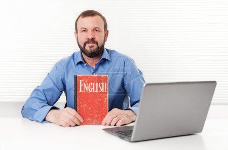 senior man with English book