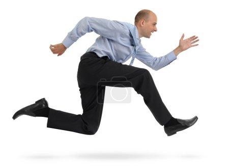 Businessman running isolated on white background