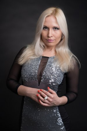 Photo for Beautiful woman with long straight blond hair. Dark background - Royalty Free Image