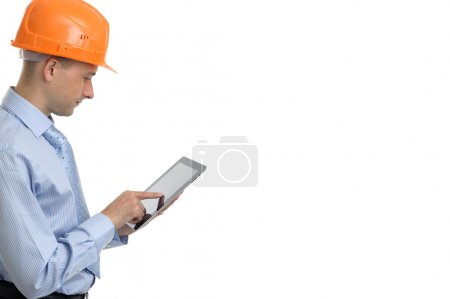 Young construction worker with digital tablet