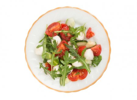 Photo for Salad from arugula tomatoes and mozzarella. Isolated on white - Royalty Free Image