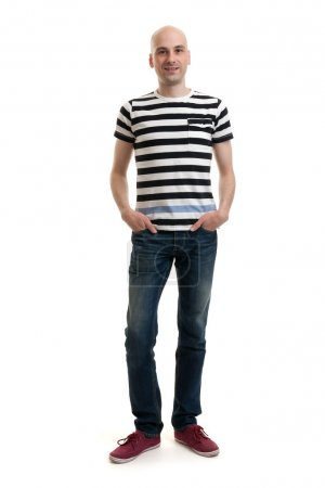 Photo for Full length portrait of a stylish young man standing over white background - Royalty Free Image