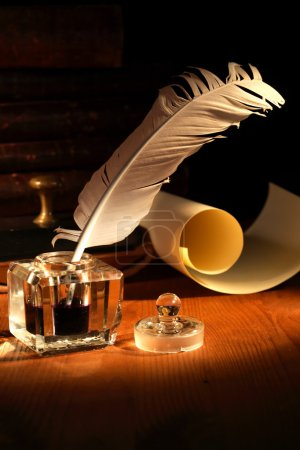 Photo for Vintage still life. Old inkstand with quill pen near scroll - Royalty Free Image