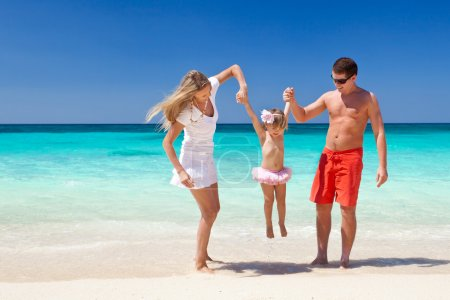 Happy family having fun on beach