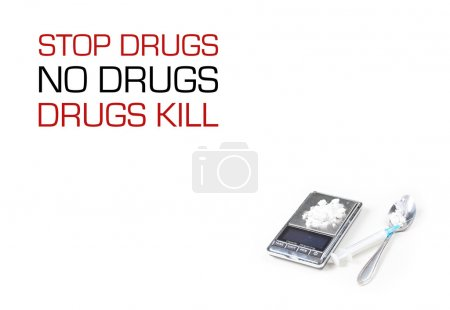 Syringe and digital scales with drugs