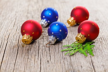 Photo for Christmas balls on wooden background with green thuja branch - Royalty Free Image