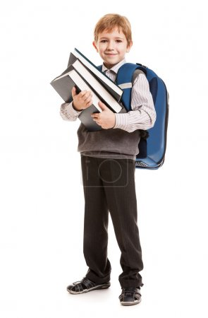 Schoolboy with backpack holding books